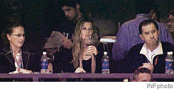 gisele grabs grapes for football