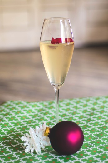 6 ounces Ruffino Prosecco .25 ounces lemon juice .5 ounces Monin Rose Water Syrup 2 drops rose water garnish with a rose petal