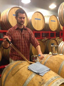 getting a Gewurztraminer barrel sample from the winemaker